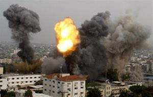 Smoke and a ball of fire are seen after an Israeli air strike in Gaza City, Wednesday, Nov. 21, 2012.