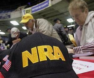 Gun owners and supporters fill out NRA applications while participating in an Illinois Gun Owners Lobby Day convention, March 7, 2012 in Springfield, Ill.