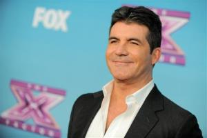Simon Cowell attends the The X Factor season finale at CBS Television City on Thursday, Dec. 20, 2012, in Los Angeles.