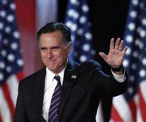 Mitt Romney waves to supporters at an election night rally in Boston.