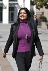 Amy Pinto-Walsh, girlfriend of artist Thomas Kinkade, leaves a San Jose, Calif., courthouse in San Jose, Calif., Monday, July 2, 2012.