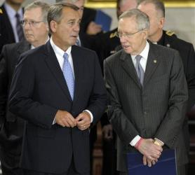 House Speaker John Boehner speaks with Senate Majority Leader Harry Reid in the Capitol Rotunda Thursday.