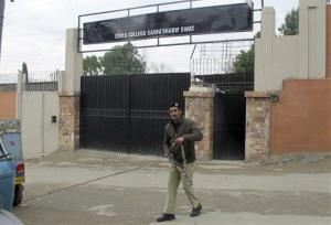 A Pakistani police officer stands guard outside the college which was named after Malala Yousufzai, in Swat, Pakistan on Friday, Dec. 21, 2012.