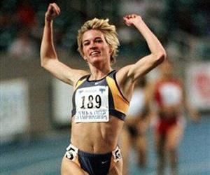 In this Feb. 27, 1999, file photo, Suzy Hamilton reacts after winning the women's 1,500 meter run at the USA Championships athletics meet in Atlanta.
