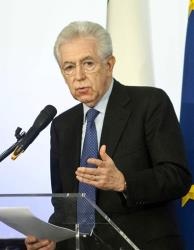 Italian Premier Mario Monti speaks during a news conference in Rome, Sunday, Dec. 23, 2012.