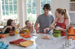 This publicity film image released by Universal Pictures shows, from left, Maude Apatow, Iris Apatow, Paul Rudd and Leslie Mann in a scene from the film, This is 40.