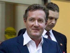 In this Dec. 20, 2011 file photo, Piers Morgan, host of CNN's Piers Morgan Tonight, leaves the CNN building in Los Angeles.