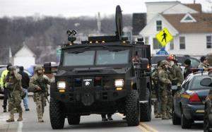A Monroe County Sheriff's Department armored truck drops off residents who were evacuated from the neighborhood in Webster, New York.