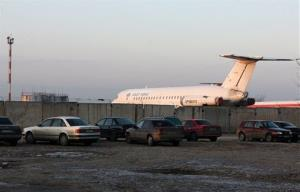 In this photo taken Saturday, Jan. 9, 2010, a plane is seen at Shymkent airport, the destination of a military transport plane that crashed this morning.