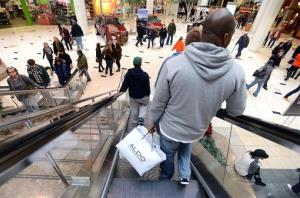 People crowd the mall for holiday shopping ahead of Christmas at Twelve Oaks Mall on Saturday, Dec. 22, 2012, in Novi, Mich.