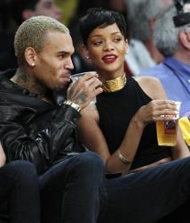 Entertainers Chris Brown, left, and Rihanna attend an NBA basketball game between the Los Angeles Lakers and New York Knicks in Los Angeles, Tuesday, Dec. 25, 2012. The Lakers won 100-94.