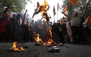 Indians burn an effigy representing rapists as they protest against the recent gang-rape of a young woman on a bus in New Delhi, India, Wednesday, Dec. 26, 2012.