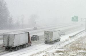 A truck parks on the side of the Ohio Turnpike in North Ridgeville, Ohio during the start of a major winter storm, Wednesday, Dec. 26, 2012.