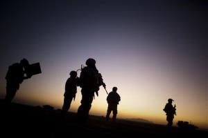 In this Sunday, Aug. 9, 2009 file photo, US soldiers patrol the outskirts of Spin Boldak, Afghanistan.