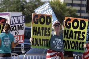 Rachel Hockenbarger from Westboro Baptist Church protests outside Reliant Stadium where The Response, a day long prayer and fast rally is being held Aug. 6, 2011, in Houston.