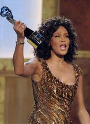 In this Saturday, Jan. 16, 2010 picture, Whitney Houston accepts an award at the Warner Theatre during the 2010 BET Hip Hop Honors in Washington.