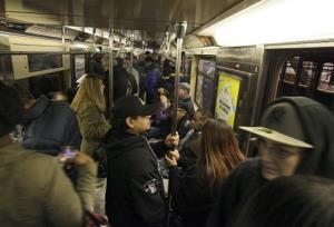 Morning commuters ride a downtown-bound, west side subway train toward New York's Times Square, Thursday, Nov. 1, 2012.