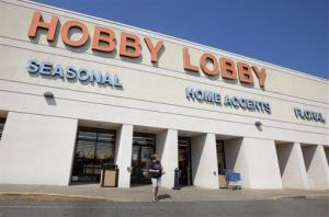 In this Sept. 12, 2012 file photo, a woman walks from a Hobby Lobby Inc., store in Little Rock, Ark.