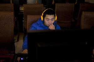 A man uses a computer at an internet cafe in central Beijing, China, Friday, Dec. 28, 2012.