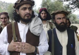 A picture of Pakistani Taliban chief Hakimullah Mehsud, left, from Oct. 4, 2009. Mehsud has said he is willing to talk with the government, but will not stop his attacks.