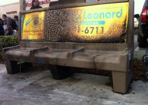 A burned city bus bench seen in the Van Nuys section of Los Angeles yesterday, after police arrested a man for allegedly setting a 67-year-old woman on fire who was sleeping on the bus stop bench.