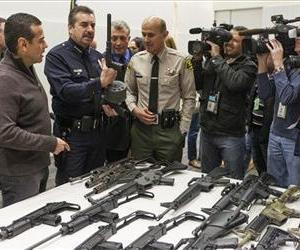 LA officials show some of the weapons collected in Wednesday's Los Angeles Gun Buyback event.
