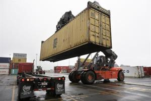 A shipping container is placed on a tractor trailer at the Port of Boston in this file photo.