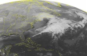 This NOAA satellite image taken Sunday, Dec. 30, 2012 at 1:45am shows strong low pressure departing the Northeast with snow over eastern New England.