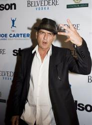 Actor Charlie Sheen stands for a photo on the red carpet at the Joe Carter Classic After-Party in Toronto on Wednesday, Aug. 15, 2012.