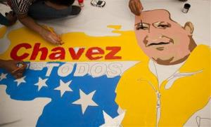 Supporters of Venezuela's President Hugo Chavez create a poster with his image alongside an outline of their country in Caracas, Venezuela earlier this month.