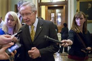 Senate Majority Leader Harry Reid, D-Nev., walks to a closed-door meeting with fellow Democrats, Sunday, Dec. 30, 2012.