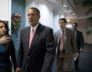John Boehner walks to a closed-door GOP caucus as Congress meets to negotiate a legislative path to avoid the so-called fiscal cliff at the Capitol in Washington, Sunday, Dec. 30, 2012.