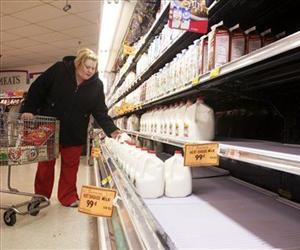 With the store shelves thinning out, Christie Wilson, Sebree, grabs a gallon of milk, Dec. 25, 2012.