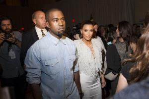 Kanye West, left, and Kim Kardashian  attend the FIJI Water-sponsored Marchesa Spring 2013 Fashion Show at Vanderbilt Hall on Wednesday Sept. 12, 2012, in New York.