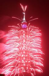 A firework display explodes off Taiwan's tallest skyscraper Taipei101 to usher in the New Year in Taipei, Taiwan, Tuesday, Jan. 1, 2013.