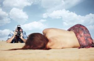 A photographer and his female subject.