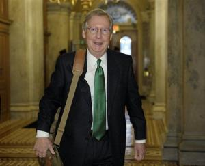 Senate Minority Leader Mitch McConnell of Ky. arrives on Capitol Hill in Washington, Monday, Dec. 31, 2012, as fiscal cliff negotiations continued.