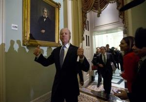 Vice President Joe Biden gives two thumbs up following a Senate Democratic caucus meeting about the fiscal cliff.