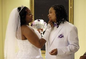 Darcia Anthony, left, and her partner, Danielle Williams chat before participating in a marriage ceremony at City Hall in Baltimore just after midnight.
