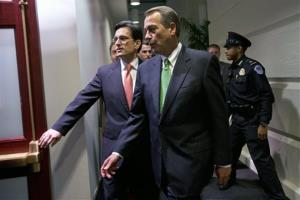 House Majority Leader Eric Cantor, R-Va., left, with Speaker of the House John Boehner, R-Ohio, enters a second Republican caucus meeting at the U.S. Capitol in Washington, on Tuesday, Jan. 1, 2013.