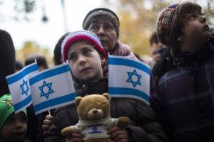 Demonstrators with Israeli flags attend a demonstration to support Israel in Berlin, Sunday, Nov. 18, 2012.