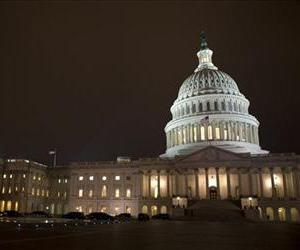 The lights of the U.S. Capitol remain lit into the night as the House, at left, continues to work on the fiscal cliff legislation proposed by the Senate, in Washington, on Tuesday, Jan. 1, 2013.