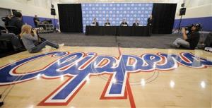 The Los Angeles Clippers logo is displayed at a press conference in this file photo.