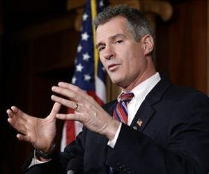 Sen. Scott Brown, R-Mass., speaks during a media availability, on Capitol Hill Tuesday, Nov. 13, 2012, in Washington.