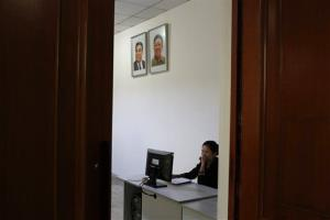 FILE - In this Sept. 20, 2012 file photo, a North Korean woman sits in a computer room near portraits of the country's late leaders, Kim Il Sung and Kim Jong Il, at the Kim Chaek University of Technology in Pyongyang, North Korea. Google's executive chairman Eric Schmidt is preparing...