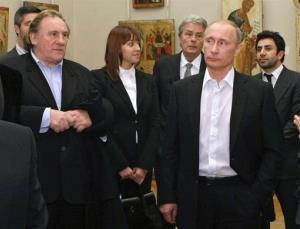 In this Saturday, Dec. 11, 2010 file photo Russian Prime Minister Vladimir Putin, right, and French actor Gerard Depardieu, left, attend the Russian Museum, in St. Petersburg.