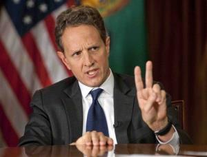This Nov. 30 photo provided by CBS News shows Treasury Secretary Timothy Geithner answering questions about the fiscal cliff.