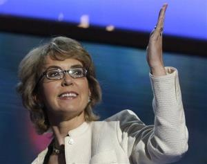 In this Sept. 6, 2012 file photo, former Arizona Rep. Gabrielle Giffords blows a kiss after reciting the Pledge of Allegiance at the Democratic National Convention in Charlotte, NC.