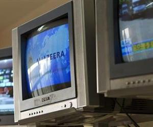 A logo of Al-Jazeera is shown on a TV  in the office of the pan-Arab news network in Beijing, China, Wednesday, May 9, 2012.