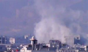 Smoke rises from buildings due to heavy shelling in the Damascus countryside, Syria, on Wednesday, Jan. 2, 2013.